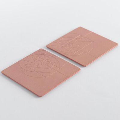 VAU, Modell 'PHI Coaster', Untersetzer, 2er Set, massives Messing, Oberfläche Kupferoptik